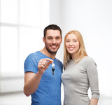 smiling couple holding keys