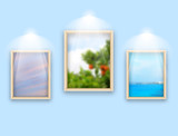 Three frames with photos hanging on wall