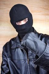 Evil criminal men in a mask