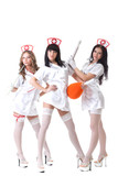 Trio of hot pretty girls posing in nurses suits