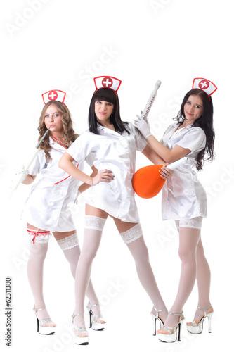 Papiers peints Gymnastique Trio of hot pretty girls posing in nurses suits