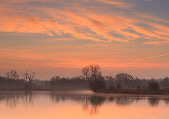Sun rising at a small pond in Holland.