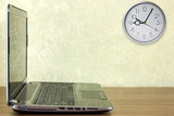 Laptop and  clock
