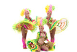 Energetic young girls dancing in carnival costumes