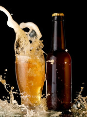 Beer glass and bottle up and splash