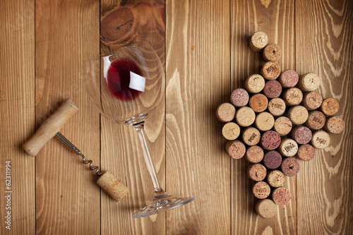 Red wine glass, corkscrew and grape shaped corks