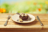Easter holiday table setting over bokeh background