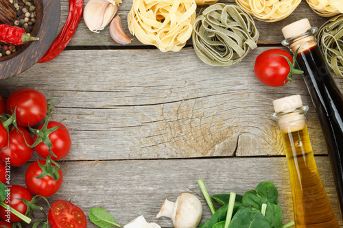 Fotobehang Groenten Fresh ingredients for cooking: pasta, tomato, mushroom and spice