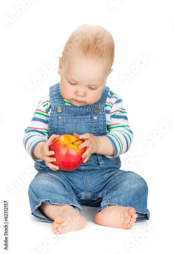 Small baby boy holding an apple