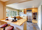 Kitchen with maple cabinets and steel appliances