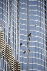Group of workers cleaning windows