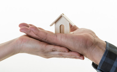 Real State Concept. Hands Holding a House