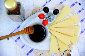 Parmesan cheese with balsamic vinegar and honey sauce