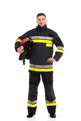 Firefighter posing with helmet under his arm
