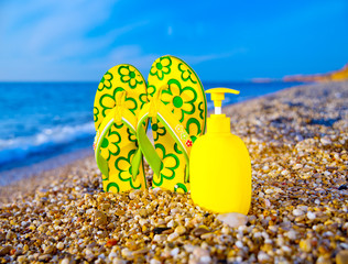 Things for the beach towel, sunscreen, flip flops