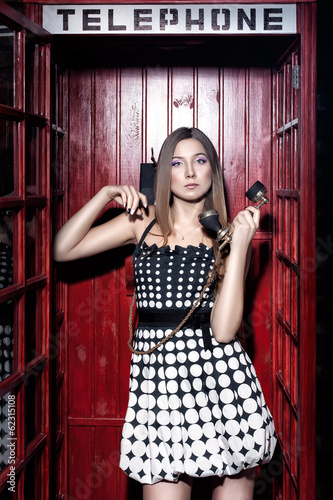 Girl in telephone booth.