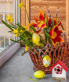 Easter decoration of willow, tulips and daffodils