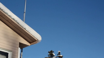 Rooftop and antenna are covered with snow