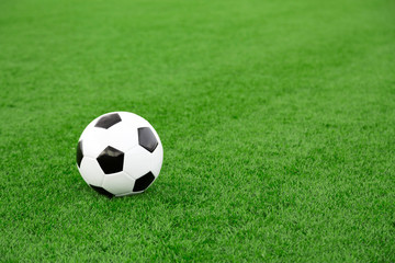 Traditional soccer ball on soccer field