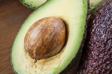 Ripe halved avocado on plate. Closeup.