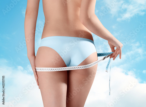 buttocks of woman Isolated on sky background, diet concept