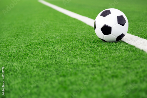 Traditional soccer ball on soccer field - 62315778