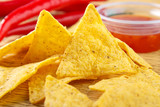 Nacho snacks with salsa dip