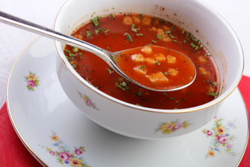 Red appetizer tomato soup with spoon