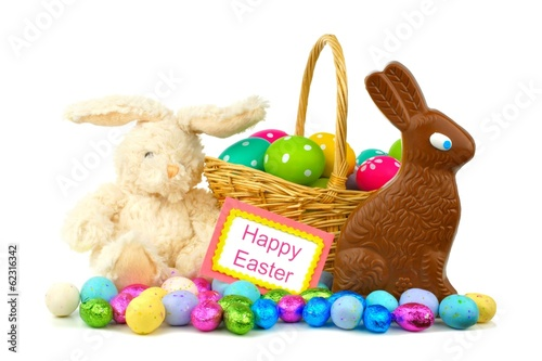 Happy Easter card with Easter basket, candies and toy bunny