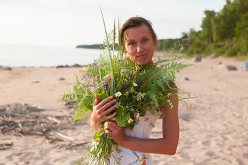 Beautiful Girl with summer bouquet.