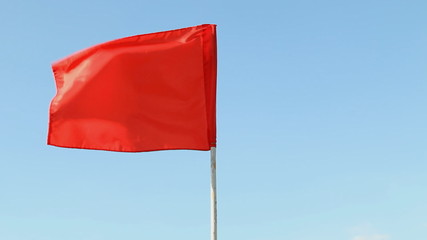 red flag in wind.