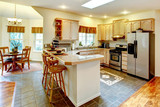 Amazing bright kitchen with maple storage combination. View of d