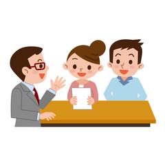受付に書類を提出する夫婦