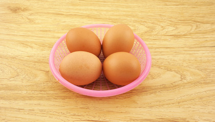 Eggs on pink basket
