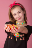 Young girl with a handful of colorful candy