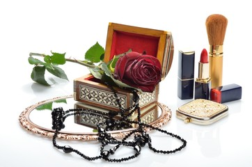 Women's jewelry, perfumes, cosmetics and flowers in still life
