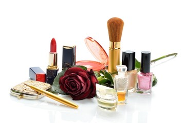 Items for decorative cosmetics makeup and red flower