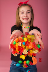 Young girl in a pool of colorful candy
