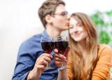 Very beautiful young couple toasting wine glasses