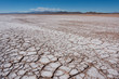 Flat saline desert, with dry and cracked ground in Bolivia. - 62318734