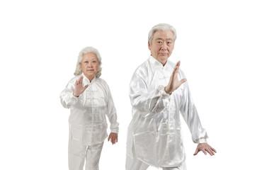 .Two senior people doing Tai Chi.
