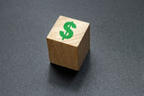 dollar sign on wood cube