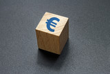 euro sign on wood cube