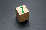 question mark on wood cube
