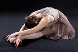 Ballet dancer bending forward