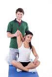 Stretching arms with trainer