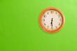 Leinwanddruck Bild - Clock showing 06:30 on a green wall