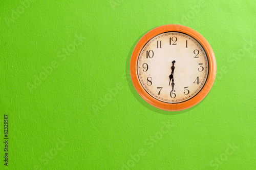Leinwanddruck Bild Clock showing 06:30 on a green wall