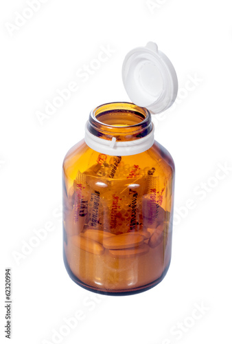 open cap of vitamin bottle isolated on white