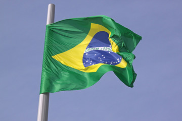flag of Brazil over blue sky